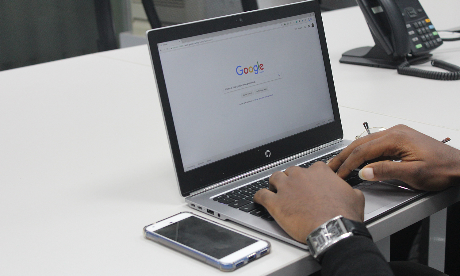 person doing a google search