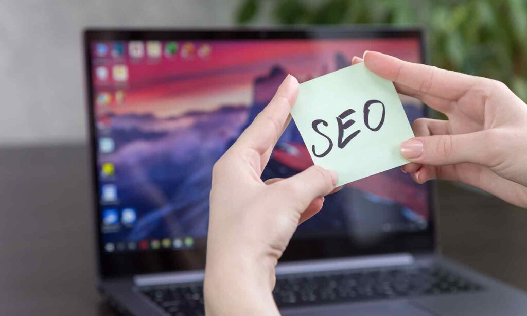 Lady looking at SEO in front of her laptop